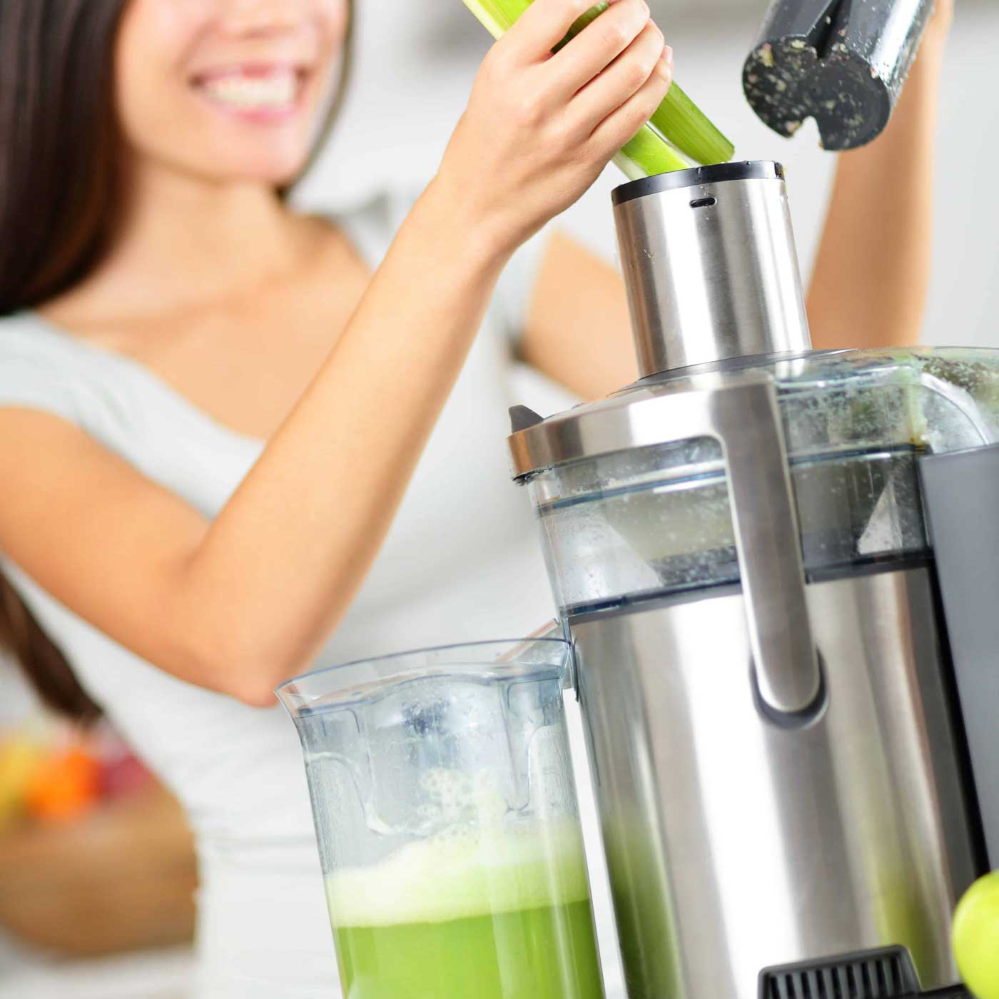 Essential Chiropractic and Healthcare Clinic - Detox and Weight Management Program Girl Doing Juice